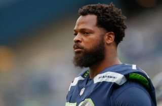 Defensive end Michael Bennett of the Seattle Seahawks looks on prior to the game against the Minnesota Vikings on Aug. 18, 2017, in Seattle, Washington.