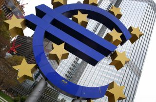 A statue of the euro symbol by German artist Ottman Hoerl stands in front of European Central Bank headquarters in Berlin.
