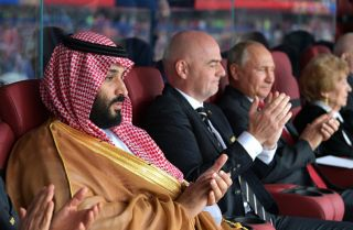 Saudi Crown Prince Mohammed bin Salman (L) and Russian President Vladimir Putin (R) watch their national teams square off in the first match of the 2018 FIFA World Cup in Moscow on June 14.