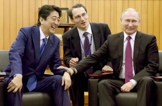 Russian President Vladimir Putin (right) and Japanese Prime Minister Shinzo Abe (left) share a laugh at the headquarters of worldwide judo community, the Kodokan Judo Institute, on Dec. 16, 2016.