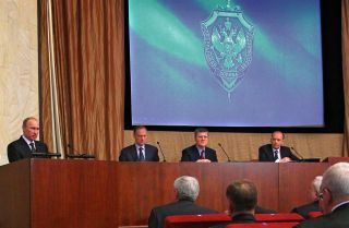 Russian President Vladimir Putin (left) addresses senior officers of the Federal Security Service during an annual meeting of top officials of the service in Moscow on Feb. 14, 2013.