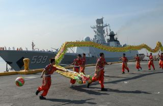 Dragon dancers perform as the Chinese guided-missile frigate Wuhu visits Manila, Philippines, in January 2019.