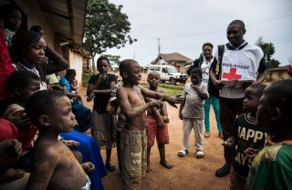 Red Cross members visit families in northeastern Democratic Republic of Congo to listen to their fear of the Ebola virus on Aug. 31, 2019.