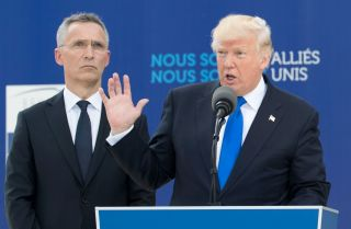 U.S. President Donald Trump and NATO Secretary-General Jens Stoltenberg speak May 25, 2017, at NATO headquarters in Brussels.