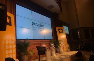 The Stratfor logo plays on the main stage screen prior to The Gulf With Mexico panel at the Texas Tribune Festival 2019.