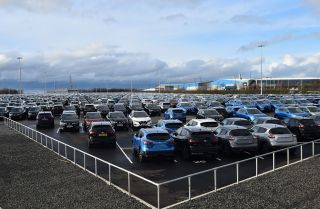 Nissan cars are pictured, parked in a lot at its' Sunderland plant in north east England on March 16, 2019.