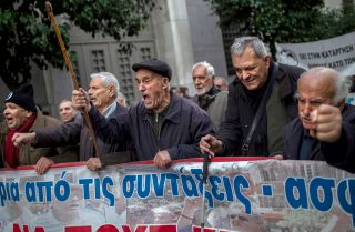 Pensioners march in central Athens on Dec. 15, 2018, during a demonstration to demand the return of pension funds lost as part of austerity measures.