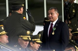 Mexican Secretary of Public Safety Genaro Garcia Luna, right, in Bogota, Colombia, on May 19, 2011.