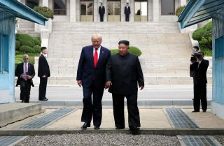 U.S. President Donald Trump and North Korean leader Kim Jong Un meet at the border village of Panmunjom in the Demilitarized Zone separating South and North Korea on June 30, 2019.