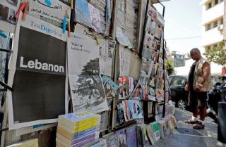 "A picture taken on Aug. 8, 2019, in Beirut shows the front pages of the Lebanese English-language Daily Star, which refrained from printing any news in protest against the country's ""deteriorating situation."""