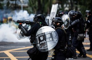Police fire tear gas to disperse protesters in the Sha Tin district of Hong Kong on Oct. 1, 2019, as the city observes the National Day holiday marking the 70th anniversary of communist China's founding.
