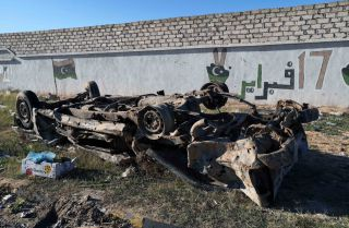 This Dec. 26, 2019, photo shows a damaged vehicle in the wake of an airstrike in Zawiya, 45 kilometers west of Tripoli.