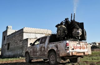Turkish-backed Syrian fighters man an anti-aircraft gun in Saraqeb, in the northwestern Syrian province of Idlib on Feb. 1, 2020.