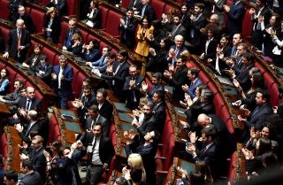 Members of the Five Star Movement political party applaud the election of one of their own, Roberto Fico, not pictured, as speaker of Italy's Chamber of Deputies in Rome on March 24, 2018.