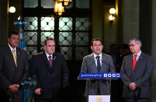 This photo shows Guatemalan President Jimmy Morales speaking to reporters during a news conference in Guatemala City on Aug. 14, 2019.