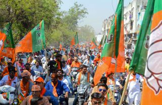 Bharatiya Janata Party supporters gather to follow national party President Amit Shah on April 6, 2019, in the Indian city of Ahmedabad.