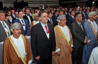 Israeli Transportation Minister Yisrael Katz, second from left, stands during the opening ceremony of the IRU World Congress, a regional transportation conference, in Muscat, Oman, on Nov. 7, 2018.