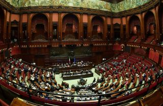 Deputies attend a session for a Parliament vote of confidence on Italy's revised 2019 budget, on December 29, 2018 in Rome.