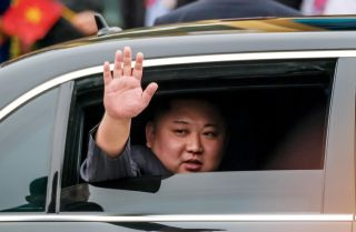 North Korean leader Kim Jong Un waves from his car after arriving in Vietnam on Feb. 26, 2019.