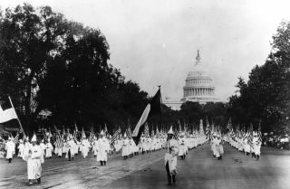 A Ku Klux Klan march Aug. 19, 1925, on Pennsylvania Avenue in Washington.