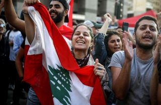 Anti-government protesters in Beirut celebrate Lebanese Prime Minister Saad al-Hariri's resignation on Oct. 29, 2019.