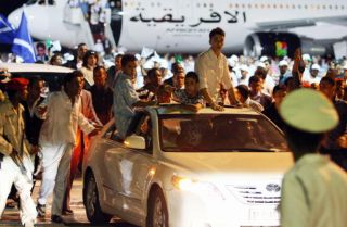 Libyans attend a welcoming ceremony for freed Lockerbie bomber Abdel Basset Ali al-Megrahi (not seen) upon his arrival in Tripoli late on August 20, 2009.