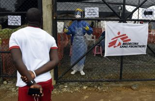 A man outside a medical center staffed by Doctors Without Borders (Medecin sans Frontiere) for people infected with the Ebola virus, Monrovia, Sept. 26, 2014.