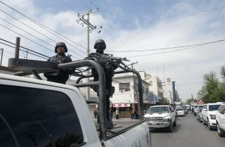Police officers patrol Nuevo Laredo, Mexico, during April 2018.
