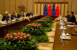Chinese President Xi Jinping, right, meets with European Commission President Jean-Claude Juncker, left, and European Council President Donald Tusk, second from left, in Beijing on July 16, 2018.