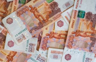 This photo is a close-up shot of Russian ruble banknotes.