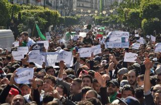 Algerians march in Algiers on March 1, 2019, against President Abdel Aziz Bouteflika's plan to run for a fifth term in April.