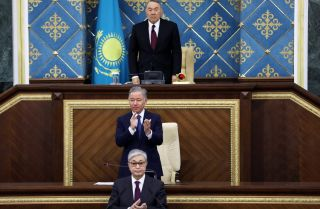 Former Kazakh President Nursultan Nazarbayev, top, and Kazakhstan's interim president Kassym-Jomart Tokayev, bottom, attend a joint session of Parliament on March 20, 2019.