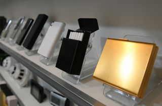 A shop in South Korea displays cigarette cases equipped with hidden cameras, among a wide selection of other spy cam devices.