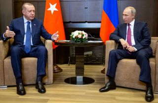 Turkish President Recep Tayyip Erdogan, left, meets with Russian President Vladimir Putin on Sept. 17, 2018, in Sochi, Russia.