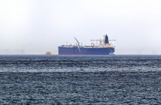 "A picture taken on May 13, 2019, shows the crude oil tanker Amjad, one of two Saudi tankers that were reportedly damaged in mysterious ""sabotage attacks,"" off the coast of the Gulf emirate of Fujairah."