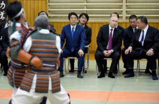 Japanese Prime Minister Shinzo Abe, third from right, and Russian President Vladimir Putin watch a judo performance in Tokyo on Dec. 16, 2016.