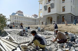 Afghan laborers work on the exterior renovation of Darulaman Palace in Kabul on Aug. 8, 2019.