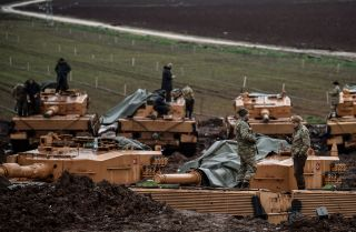Turkish tanks and troops wait along the Syrian border Jan. 25, 2018, during Operation Olive Branch, an incursion into Afrin canton.