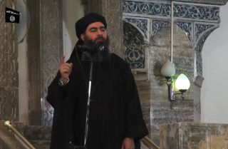 An image grab from a 2014 propaganda video released by al-Furqan media allegedly showing Islamic State Abu Bakr al-Baghdadi addressing worshippers at a mosque in the Iraqi city of Mosul.