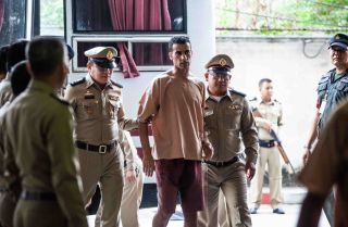 Soccer player Hakeem al-Araibi, who is facing extradition from Thailand to Bahrain, arrives for a court hearing in Bangkok on Feb. 4, 2019.