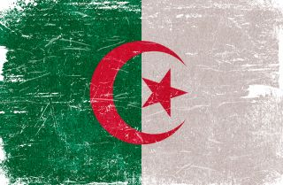 An image of the Algerian flag. Plummeting oil demand and prices due to the COVID-19 crisis havesapped the Algerian government of its primary revenue source.