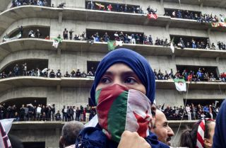 Protesters rally in Algiers on March 8 against President Abdel Aziz Bouteflika's bid for a fifth term. Bouteflika announced on March 11 that he would not seek re-election and then postponed the country's April 18 presidential election.