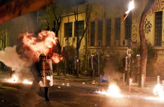 Greek riot police clash with anarchist protesters in Athens on Dec. 6, 2015. Anarchism continues to survive — and inspire — to this day, gaining momentum across the West as nationalism spreads.