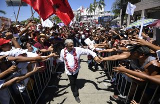 Presidential front-runner Andres Manuel Lopez Obrador greets supporters at a rally in Acapulco, Mexico, on June 25, 2018.