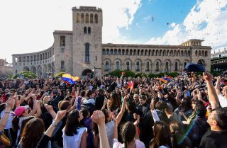 Armenians in the capital Yerevan celebrate Serzh Sarkisian's resignation as prime minister on April 23, 2018.