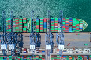 An aerial view of harbored shipping cargo.