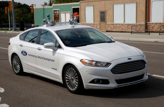 A fully autonomous Ford Fusion wends its way through a test course in Ann Arbor, Michigan.