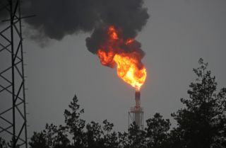 An image of a gas flare at the Mozyr Oil Refinery in Belarus on Jan. 4, 2020. Russia recently resumed its oil deliveries to Belarus after a pricing dispute prompted Moscow to halt its supplies at the beginning of the year.