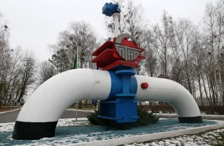 A monument depicts an oil pipeline near the Mozyr linear production dispatching station in Belarus on Jan. 4, 2020.