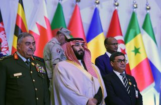 Saudi Defense Minister and Crown Prince Mohammed bin Salman, center, stands for a photo-op with his counterparts from other countries in Saudi Arabia's Islamic Military Counterterrorism Coalition at a meeting in Riyadh.